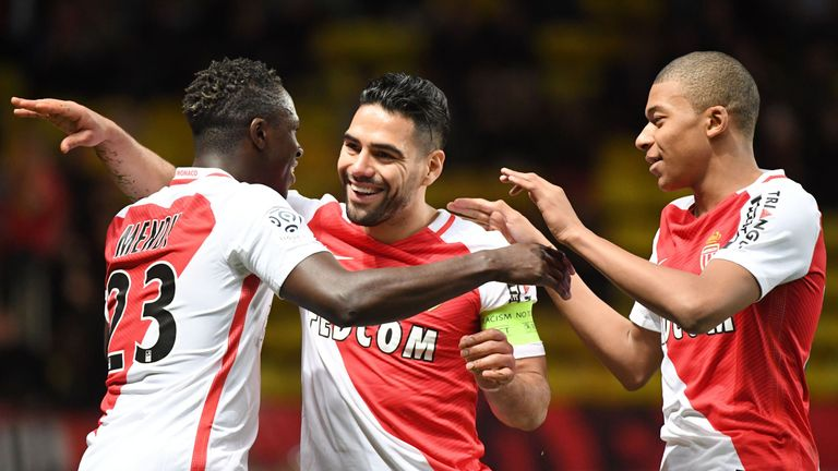 Monaco's Colombian forward Radamel Falcao is congratulated by his teammates, including Kylian Mbappe Lottin (R), after scoring a goal during the French Lig