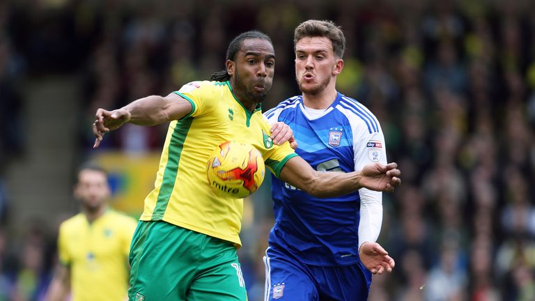 Cameron Jerome and Emyr Huws battle for possession at Carrow Road