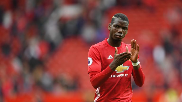 MANCHESTER, ENGLAND - SEPTEMBER 24:  Paul Pogba of Manchester United shows his appreciation for the fans after the final whistleduring the Premier League m