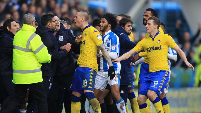 Tempers flare on the touchline as Huddersfield Town manager David Wagner (left) and Leeds United's Pontus Jansson (centre) confront each other