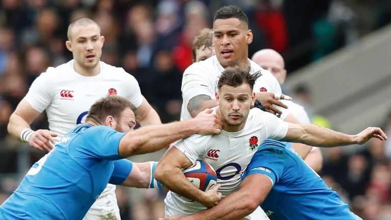 Danny Care is tackled by Lorenzo Cittadini (L) during the Six Nations match between England and Italy at Twickenham