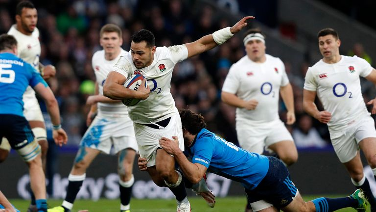 Ben Te'o is tackled by Italy's centre Luke McLean during the Six Nations match at Twickenham