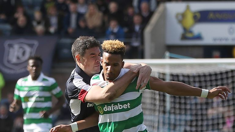 Darren O'Dea of Dundee vies with Scott Sinclair of Celtic