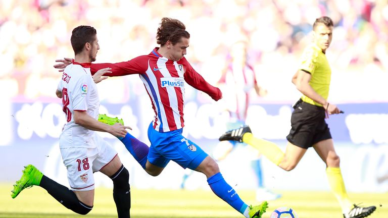 Antoine Griezmann competes for the ball with Sergio Escudero (left)
