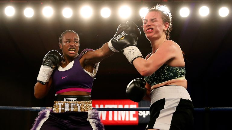 Clarissa Shields lands a punch on Szilvia Szabados during their historic headline fight