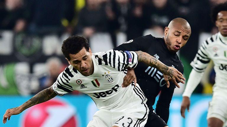 Dani Alves (L) vies with Porto midfielder Yacine Brahimi