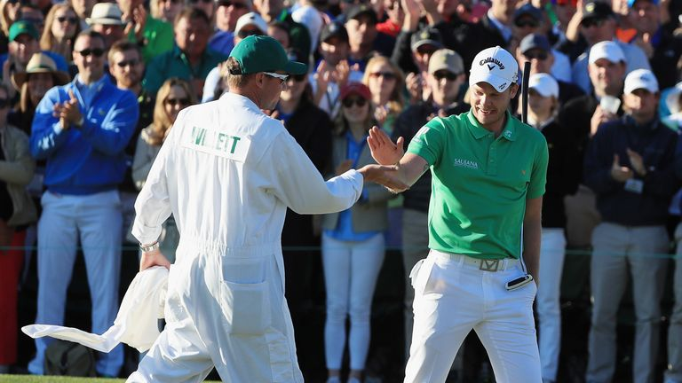 Danny Willett celebrates with Jonathan Smart after holing out on the 18th green