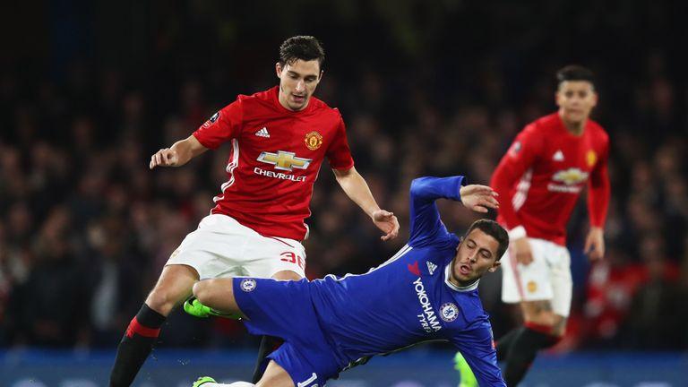 Hazard is challenged by Matteo Darmian