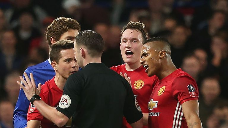 Manchester United players protest Michael Oliver's decision to send off Ander Herrera in the recent FA Cup tie at Chelsea