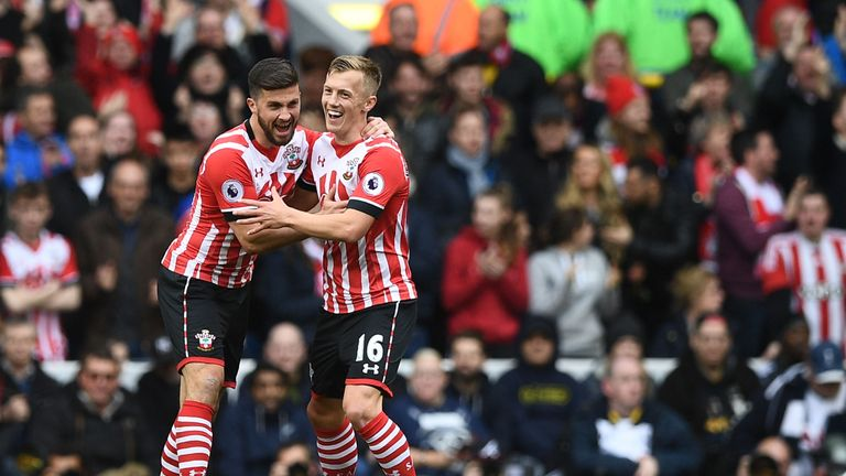 James Ward-Prowse celebrates with Shane Long after pulling a goal back for Southampton