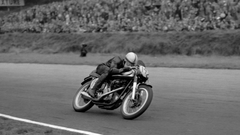 John Surtees streaks round Brands Hatch on his way to victory over World Motorcycle champion Geoff Duke