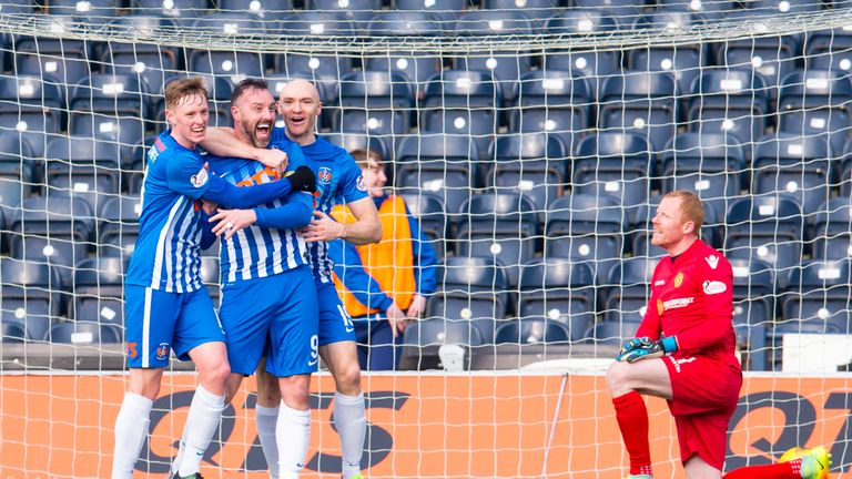 Kris Boyd (centre) celebrates his 200th league goal with Conor Sammon (right) and Sean Longstaff but missed a late penalty against Motherwell as Kilmarnock lost 2-1
