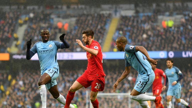Lallana is closed down by Yaya Toure and Fernandinho