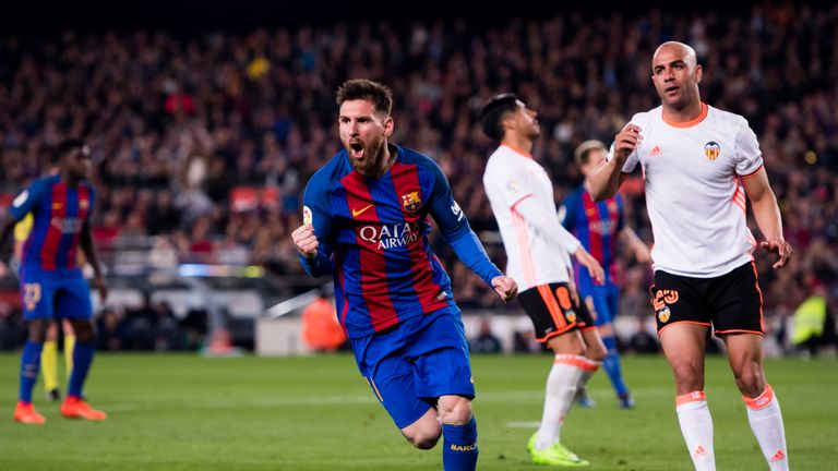 Lionel Messi celebrates after scoring Barcelona's third goal.