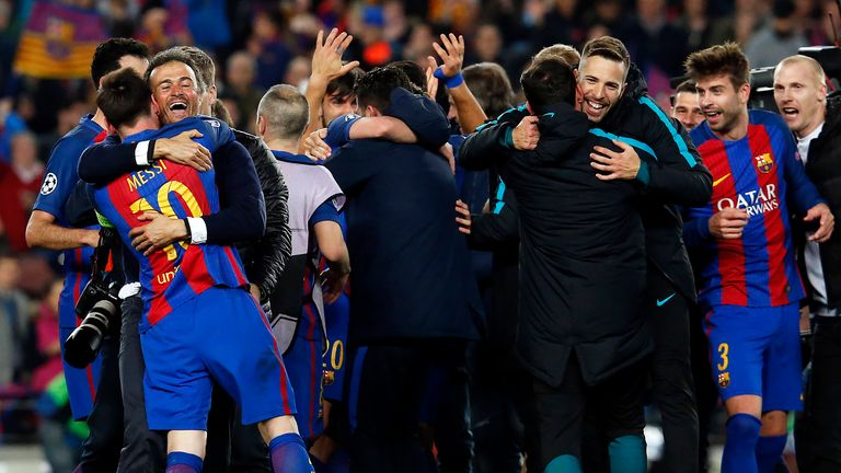 Luis Enrique and Lionel Messi embrace after the match