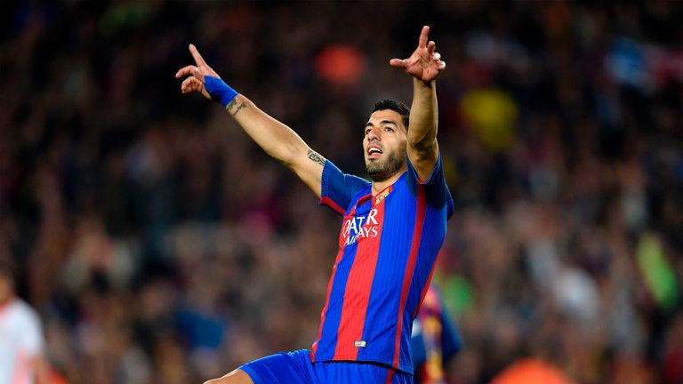 Luis Suarez celebrates after making it 1-1