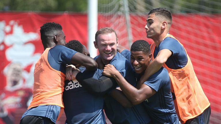 Axel Tuanzebe, Timothy Fosu-Mensah, Wayne Rooney, Marcus Rashford and Andreas Pereira joke around during Man United training