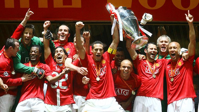 Manchester United players celebrate with the Champions League trophy in Moscow in 2008