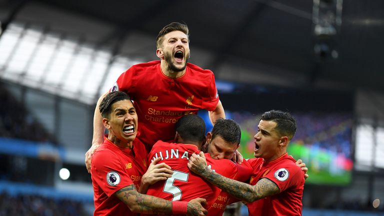 James Milner (C) celebrates with team-mates after giving Liverpool a 1-0 lead