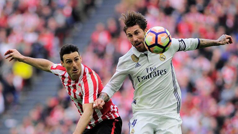 Real Madrid's Sergio Ramos vies with Athletic Bilbao's Aritz Aduriz