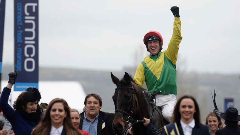 The 'intruder' (blue shirt) leads Sizing John in