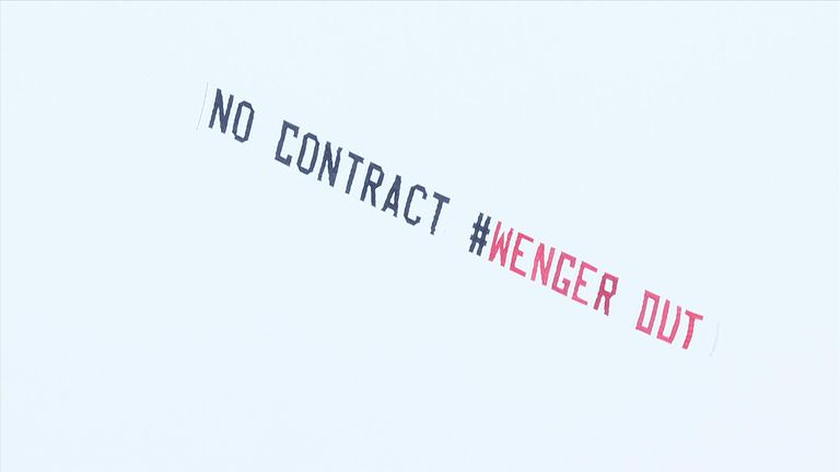 One banner flown over The Hawthorns called for the Arsenal boss to leave...