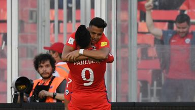 Alexis Sanchez celebrates with Esteban Paredes