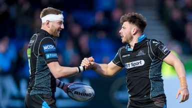 Warriors' Finn Russell and Ali Price celebrate Price's try