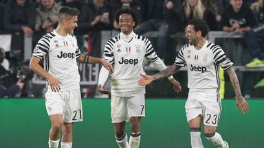 Juan Cuadrado (C) was on target for Juventus