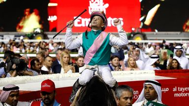 Mike Smith celebrates success in the 2017 Dubai World Cup aboard Arrogate.