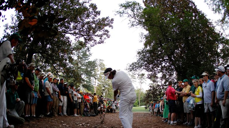 AUGUSTA, GA - APRIL 08:  Bubba Watson of the United States plays at a shot from the rough on second sudden death playoff hole on the 10th during the final