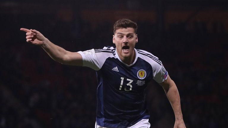 Chris Martin shrugged off jeers to score a crucial goal for Scotland against Slovenia