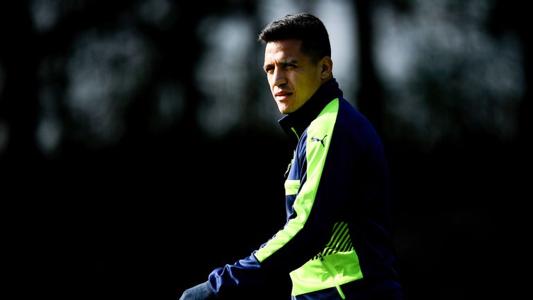 Alexis Sanchez arrives for training at London Colney