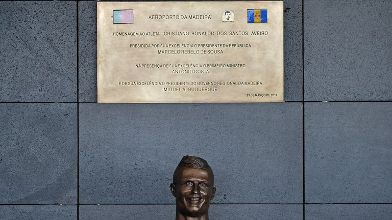 The statue of Cristiano Ronaldo is unveiled at the ceremony at Madeira Airport
