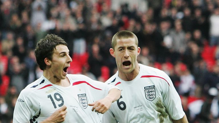 LONDON - MARCH 24:  Matt Derbyshire of England (L) celebrates with Gary Cahill as he scores their third during the U21 International Friendly match between