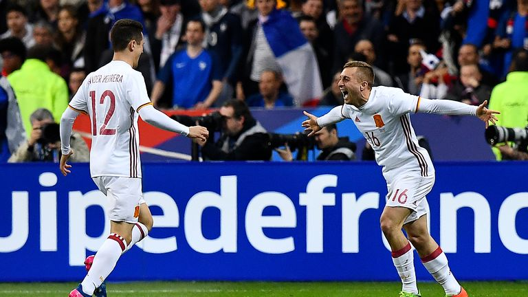 Spain's midfielder Gerard Deulofeu celebrates after scoring Spain's second goal against France