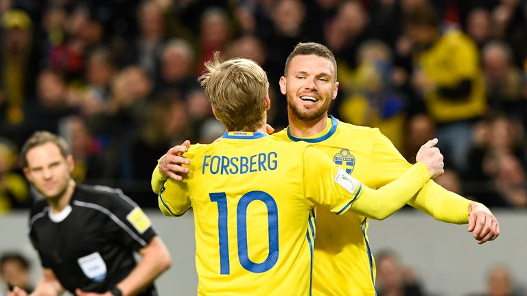 Sweden's midfielder Emil Forsberg celebrates with his teammate forward Marcus Berg (R) after scoring  during the FIFA World Cup 2018 qualification football