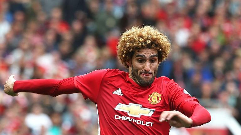 Marouane Fellaini in action during the Premier League match between Manchester United and Manchester City at Old Trafford