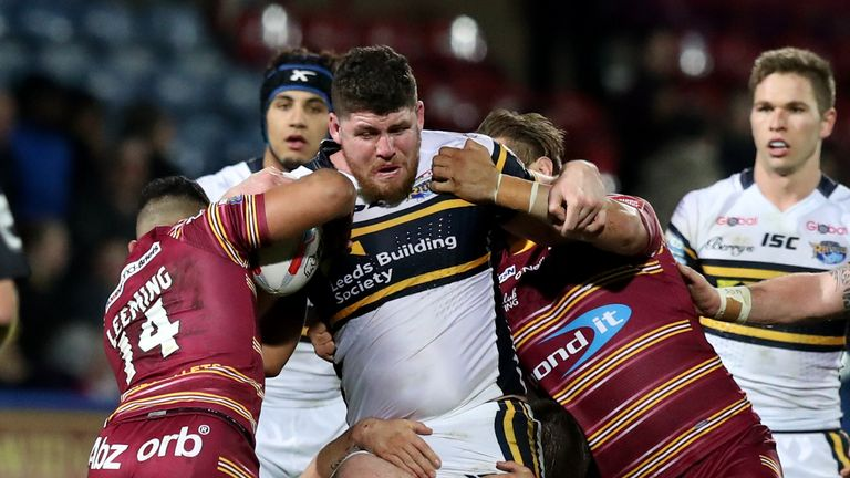 Mitch Garbutt is tackled by the Huddersfield defence
