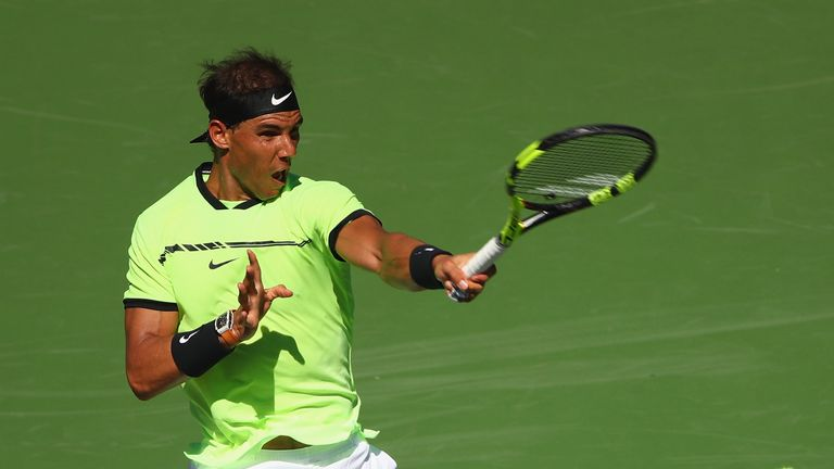 INDIAN WELLS, CA - MARCH 12:  Rafael Nadal of Spain plays a forehand against Guido Pella of Argentina in their second round match during day seven of the B