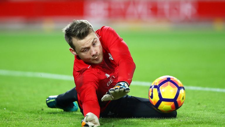 Simon Mignolet warms up prior to the Premier League match between Liverpool and Manchester City at Anfield