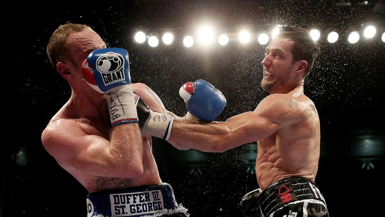 George Groves and Carl Froch in action during their IBF and WBA World Super Middleweight bout at Wembley Stadium
