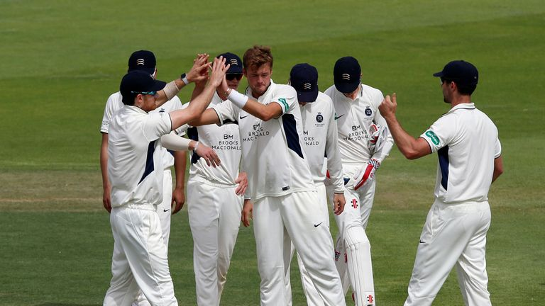 Tom Helm (M) of Middlesex takes the wicket of Adam Lyth of MCC during day one of the Champion County match