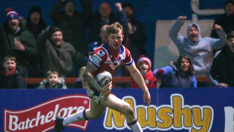 Wakefield's Tom Johnstone runs in for a try.