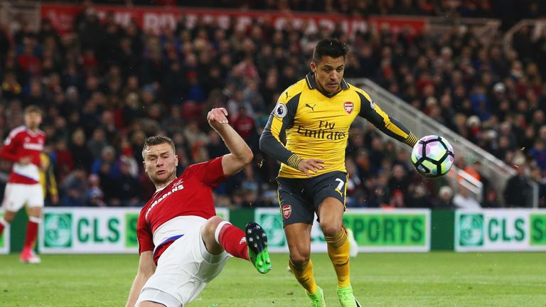 Alexis Sanchez of Arsenal is challenged by Ben Gibson of Middlesbrough