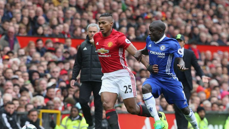 Antonio Valencia and N'Golo Kante battle for the ball