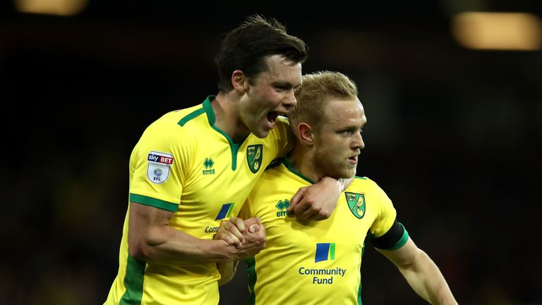 Alex Pritchard (right) celebrates after a fortunate opener