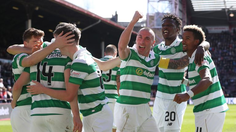 Celtic players celebrate a goal