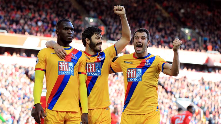 Benteke (left) celebrates one of his 17 goals for Palace last season