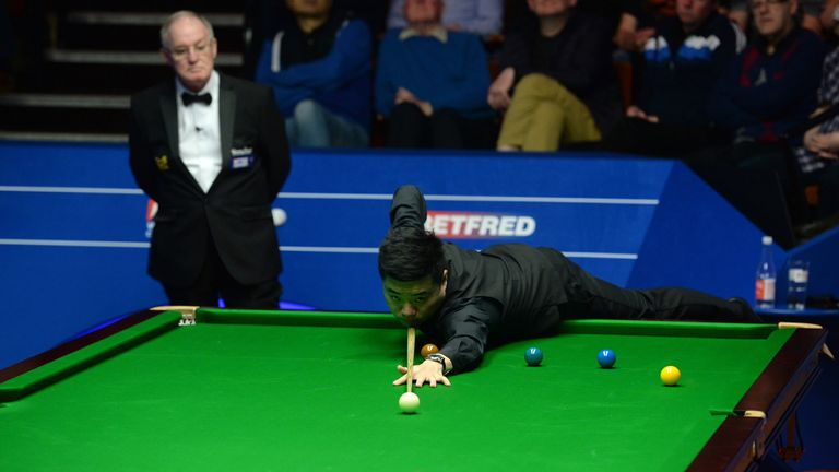 Ding Junhui at the table in his match against Zhou Yuelong on day four of the Betfred Snooker World Championships at the Crucible Theatre, Sheffield.